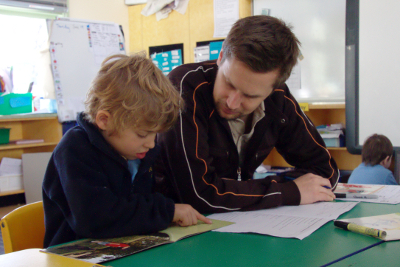 teacher and student working together