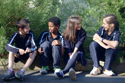 school captains sitting on the ground having a conversation