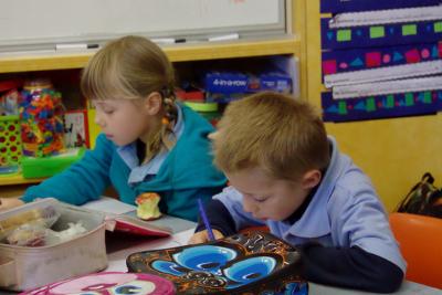 children sitting at their desks